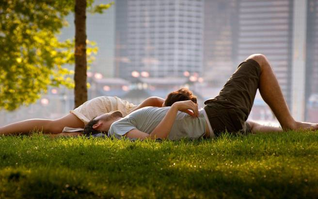 Couple-Relaxing-Grass
